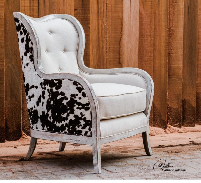 Uttermost Chalina Armchair. Curvy, exposed wood frame is solid hardwood in an aged, bone-white finish, separating the dark chocolate and milky white velvet outer surround from the soft, neutral linen box cushion and tufted inside back.