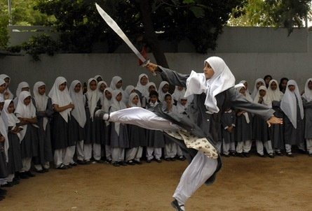 Muslim school girls from St. Maaz high school practising Chinese wushu martial arts inside the school compound in the southern Indian city of Hyderabad.