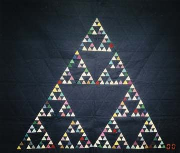 Mathematical Quilts by Elaine Krajenke Ellison.  This one: Sierpinkskis Triangle - Waclaw Sierpinski, 1882-1969, was a Polish mathematician that  was very interested in patterns, including Pythagorean triples. This triangle, a fractal,  was found on the floor of a church in Anagni, Italy. This oldest fractal dates to 1104. It is  said that this fractal, named after Sierpinski, is the first fractal in the fractal alphabet. The  quilt is owned by the London Science Museum.
