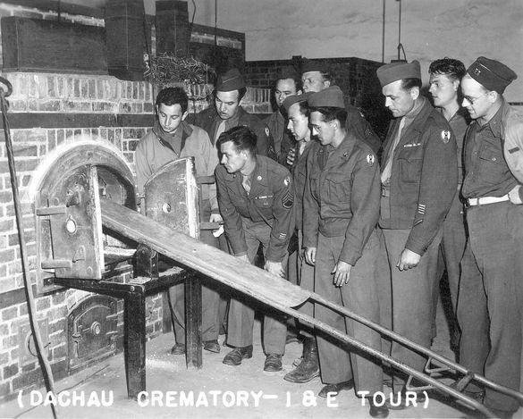 Dachau, Germany, 1945, American soldiers observing the crematorium. - Yad Vashem Photo Archive