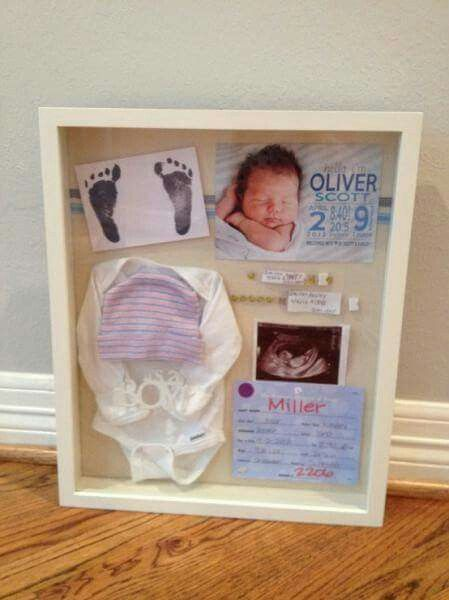 Shadow box idea for first onsie, beanie, sonogram, and birth announcement.