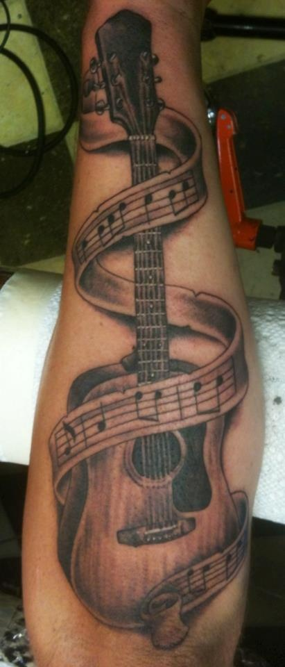 Black and Grey Guitar With Music Notes Tattoo By Russell Fortier at Lucky 7 Tattoo-Tahoe