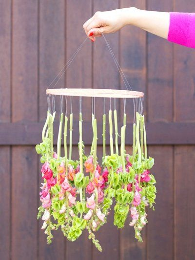 Though this hanging flower chandelier won't bring you light in the illuminating, 'now I can read without forceful squinting' sense, it will brighten up a room by the pure fact that it's constructed from dozens of cheerful, dangling blooms.