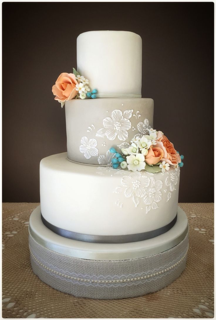 Peach & turquoise wedding cake with vintage style lace brush embroidery