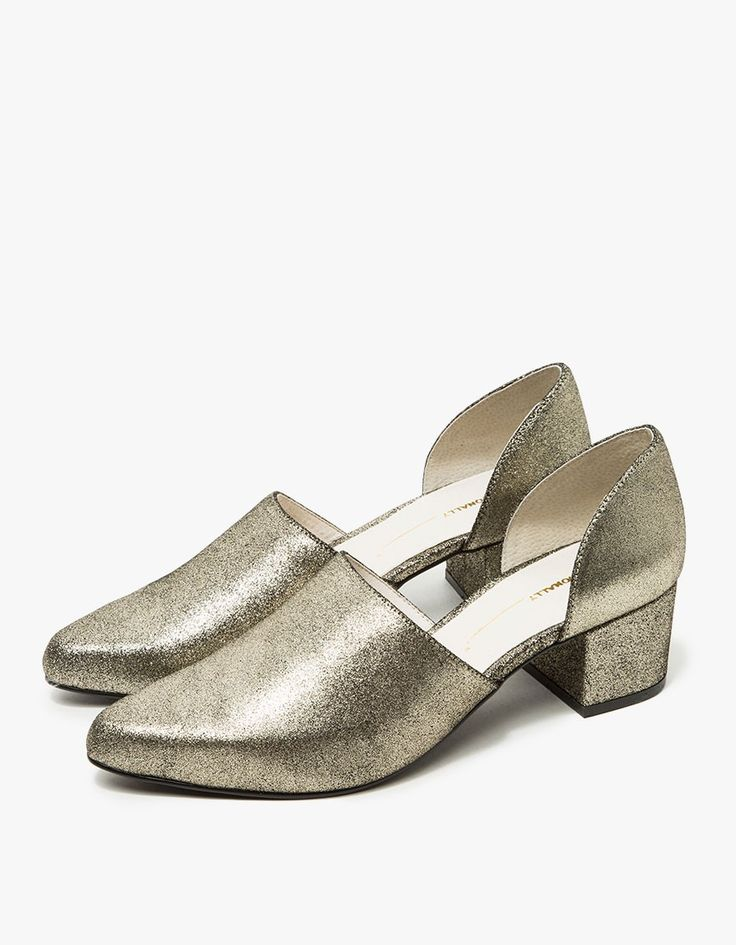 Slip-on heel from Intentionally Blank in Gold. Pointed toe. Concealed elastic goring at inside vamp. Leather lining. Padded footbed. Leather-wrapped block heel with rubber cap.  • Leather upper • Leather sole • Women's sizes listed