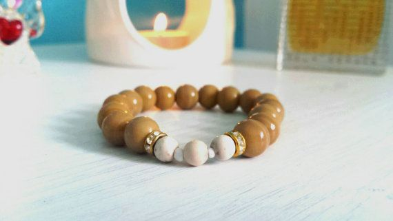 Made with genuine petrified wood and howlite gemstones. Spiritual prayer yoga mala bracelet. View our shop for more info