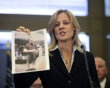 FBI specIal agent Teresa Carlson holds a photo of guy the FBI wants to interview and is asking for info at a press conference on the shooting at the Sikh Temple of Wisconsin where a gunman fired upon people at service August, 6, 2012 in Oak Creek, Wisconsin. At least six people were killed when the shooter identified as Wade Michael Page opened fire on congregants in the Milwaukee suburb. The suspect was a U.S. veteran. - http://www.PaulFDavis.com/diversity-speaker (info@PaulFDavis.com)