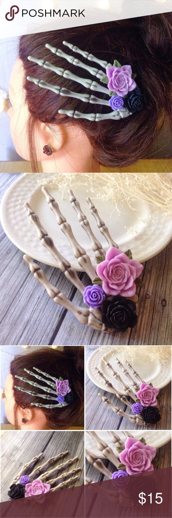 """Large skeleton hand hair clip with roses This lovely skeleton hand hair clip is adorned with black, violet and lavender roses. Hand measures almost 5"""". Definitely a statement pieceAn alligator clip is securely attached to the back and works well for all hair types. A perfect Halloween accessory, or if you like being spooky all yearHandmade by me & brand new. I also can do custom colored roses. Bundle & save 15% on 3+ items! Tags: October, autumn, fall, pinup,rockabilly,pastel,gothic,goth..."""