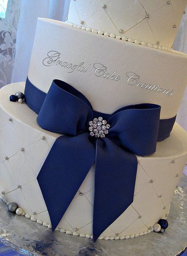 Beautiful elegant cake - love the Purple Fondant Bow with a little bling added.
