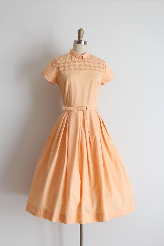 Super adorable peachy cotton day dress from the 1950s. This dress features a…