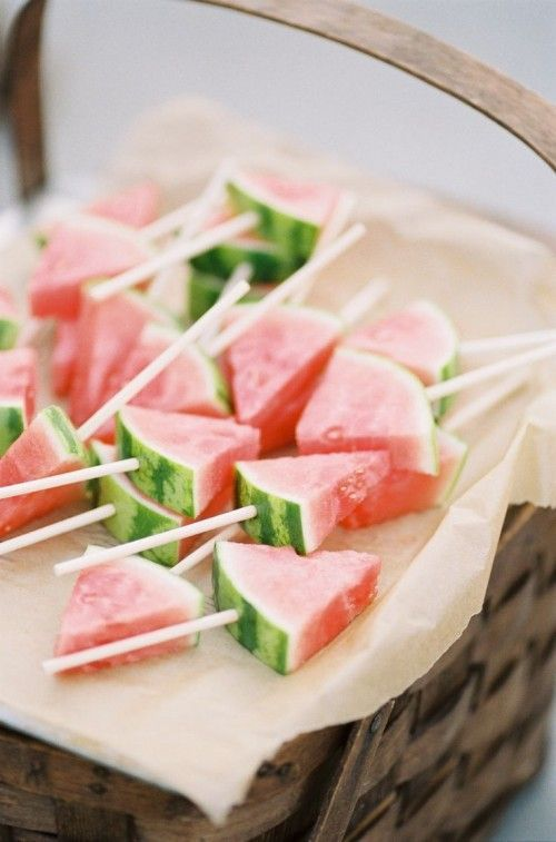 These watermelon slices on a stick are the perfect refreshing yet healthy snack to serve at a bridal shower!