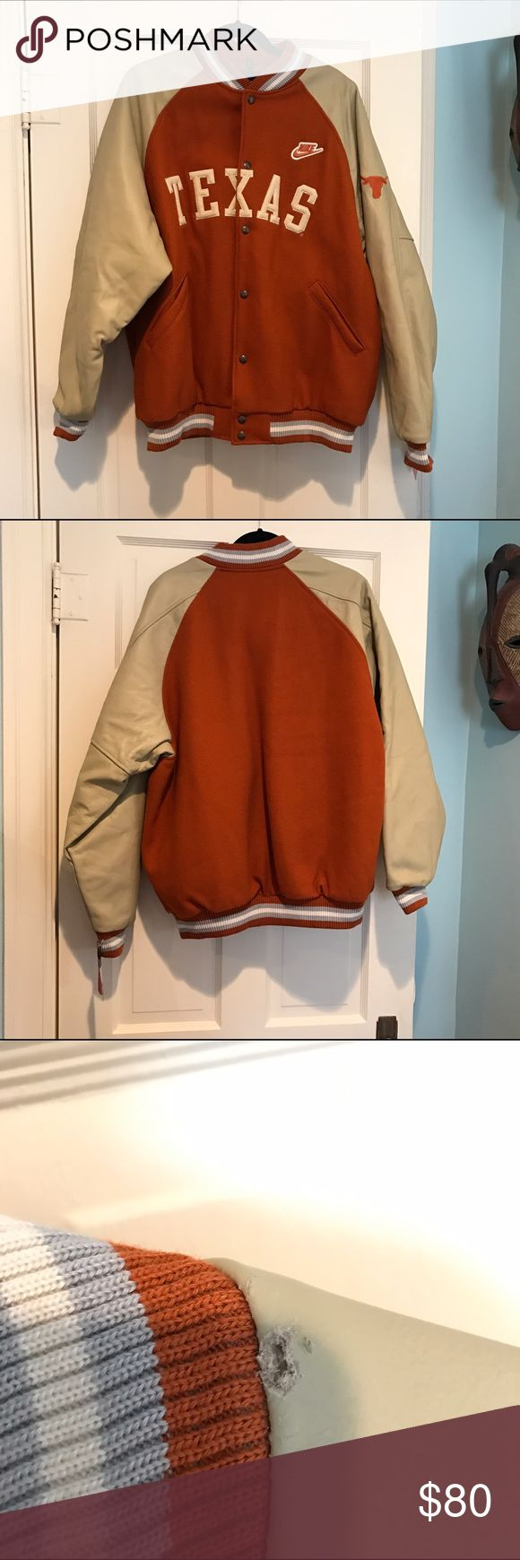 NWT Nike Texas Letterman Jacket Men's Large. Leather sleeves with cloth body. Quilted inside that I'm sure is warm. Longhorn patch on left arm. Slight damage at the neckline as seen in the third picture. Nike Jackets & Coats Bomber & Varsity