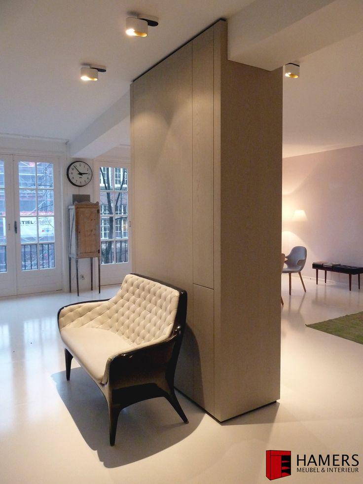 Custom made pillar. TV and beamer integrated. Oak veneer. Amsterdam. Design.