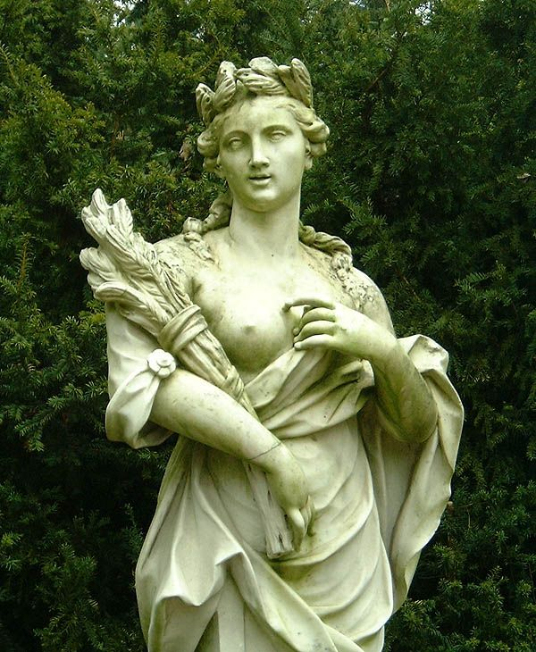 Demeter - was the great Olympian goddess of agriculture, grain, and bread, the prime sustenance of mankind. She also presided over the foremost of the Mystery Cults which promised its intiates the path to a blessed afterlife. Demeter was depicted as a mature woman, often crowned and holding sheafs of wheat and and a torch.