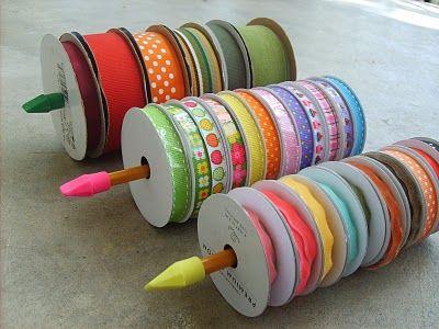 DIY Ribbon Organizer : unsharpened pencils or wooden dowels + erasers on both ends = ribbon holder