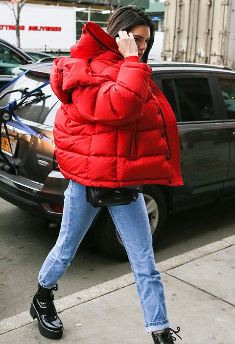 Kendall Jenner wearing a red oversized puffer jacket | ASOS Fashion & Beauty Feed