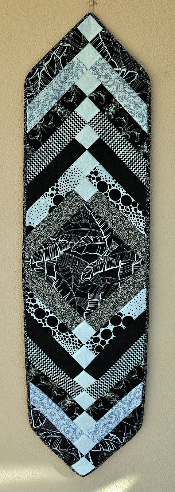 This modern quilted table runner in all black and white 100% cotton fabrics will go with everything! It is braided and strip-pieced. I used a