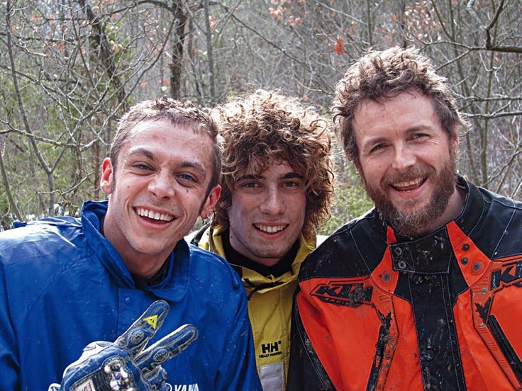 Jovanotti (right) with Valentino Rossi (left) and ..Simoncelli after a motor bike race
