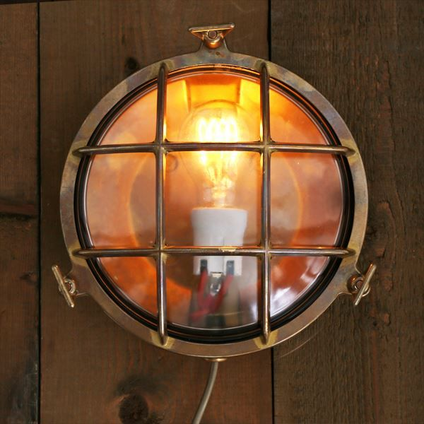 Inspired in 1950s ship lights, the Adoo Marine Nautical Wall Light adds nautical charm and can be used as a wall or ceiling fitting both indoors or outdoors. This marine bulkhead light is suitable for any minimalist or industrial style setting. An interesting take on nautical lighting add this fixture to beach front properties or pool houses. #nauticallight #outdoorlight #marinelight #bulkheadlight #wallsconce #lighting