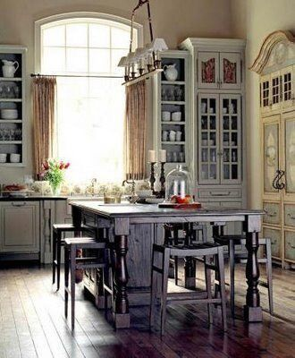 Love the mix of cabinets, the height of the cabinets and the patina, the window!