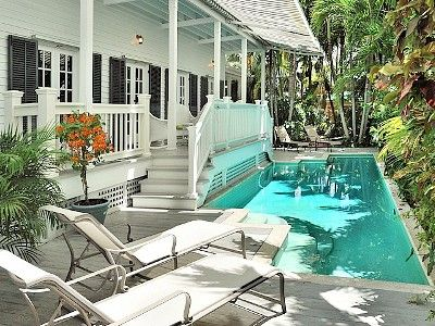 Key West house rental - The pool area has plenty of chaises. Retractable awning provides shade if needed