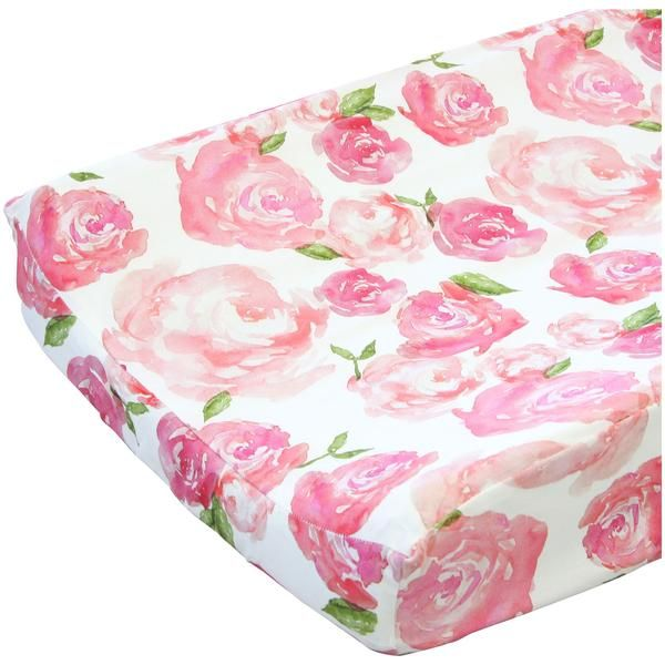 Our Harlow's Watercolor Rose Floral changing pad cover features a fun and playful watercolor rose print on a white background that fits in any modern baby girl's nursery easily. This modern floral changing pad cover will be sure to bring an element of style and smiles to any changing table with it's light pinks and just a touch of green.