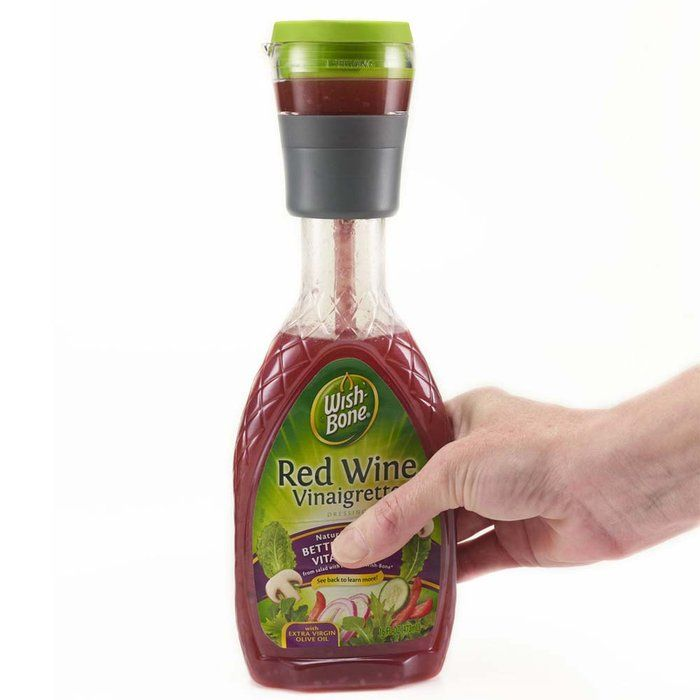 Dressing Lid measures one serving of salad dressing by simply squeezing bottle.