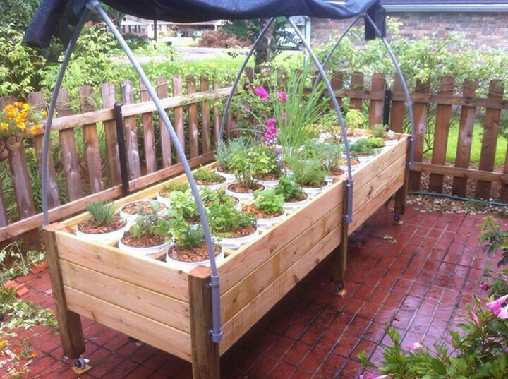 All season self watering container garden system the arch for Watering vegetable garden