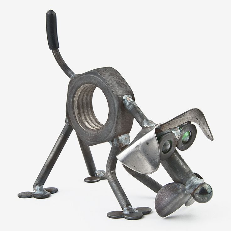 Handcrafted in Kentucky, this adorable Baby Nuts the Dog Sniffing is made using scrap and reject metal, and features colored glass marble eyes. These quintessentially cute critters make the ultimate g