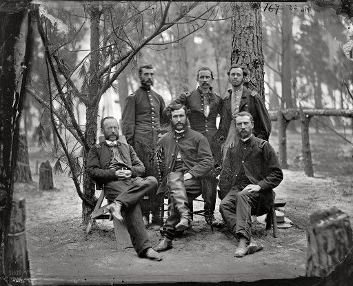 "July 1864. ""Broadway Landing, Virginia. Surgeons of 4th Division, 9th Army Corps, in front of Petersburg."" Main Eastern theater of war, the siege of Petersburg. Wet plate glass negative, photographer unknown."
