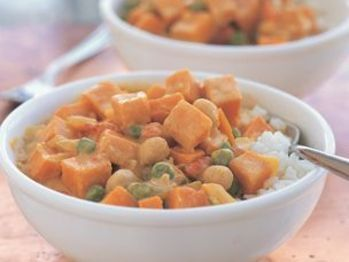 Chickpea and Sweet Potato Curry with tomato, garlic, garbanzo beans, sweet potato, ginger, basmati rice, salt, coconut milk, yellow onion, and curry powder.