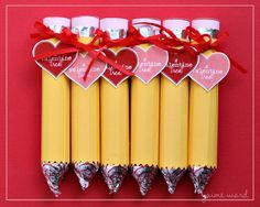 "Valentine Pencil Treat: Cut 3.5"" x 4.5"" piece of yellow card stock & score every 1/4"" inch, lengthwise. Work pinking scissors along short side of paper & wrap paper around Rolos bar. Cinch w/double-sided tape or scrapbook glue. Cut 3.5"" x 3/8"" pink card stock. Wrap around top of Rolos to create eraser, cut out circle on pink card stock to create top of eraser. Cut 3.5"" x 3/8"" piece of foil & use to cover seam where yellow & pink meet. Glue a Hershey's kiss to other end of Rolos  pencil point"