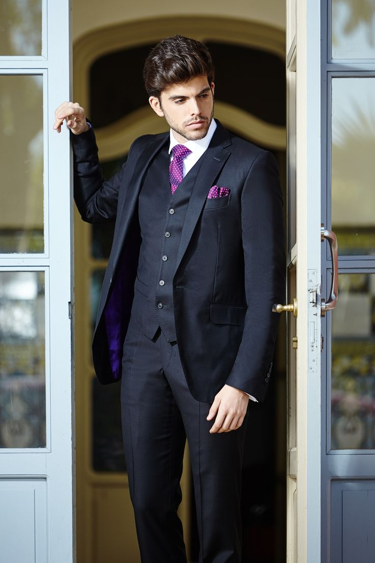 Men's black tailored three-piece suit with contrast lining.