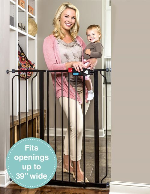 The Regalo Black Easy Step Extra Tall Baby Gate stands tall to keep children from climbing, while featuring an easy walk through door for adults to pass.