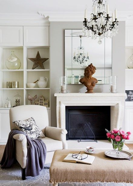 French style in Sydney A limestone fireplace from The Country Trader forms the living room's focal point beneath the elegant chandelier -  Home Beautiful