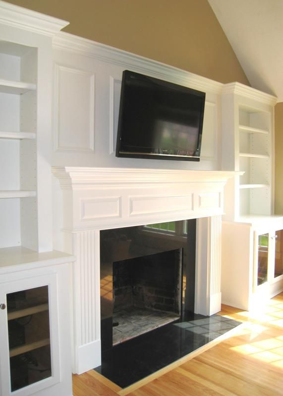 Fireplace and alcove cupboards.....LOVE