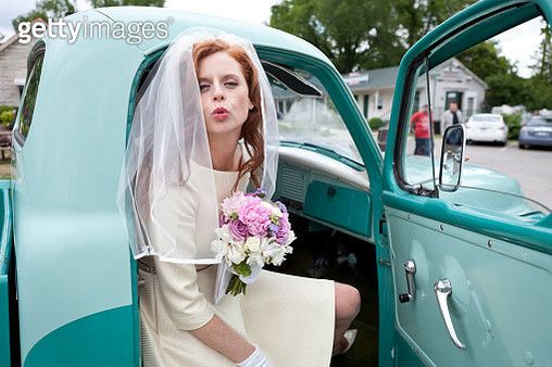 Bride blowing a kiss from vintage truck - gettyimageskorea