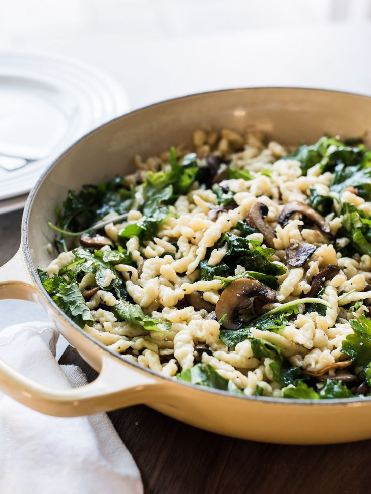 Spaetzle with Garlic Butter Mushrooms and Baby Kale is pure comfort food, and a side dish that will go with just about everything. This German egg dumpling is so easy, you'll be tempted to make these homemade noodles every day!