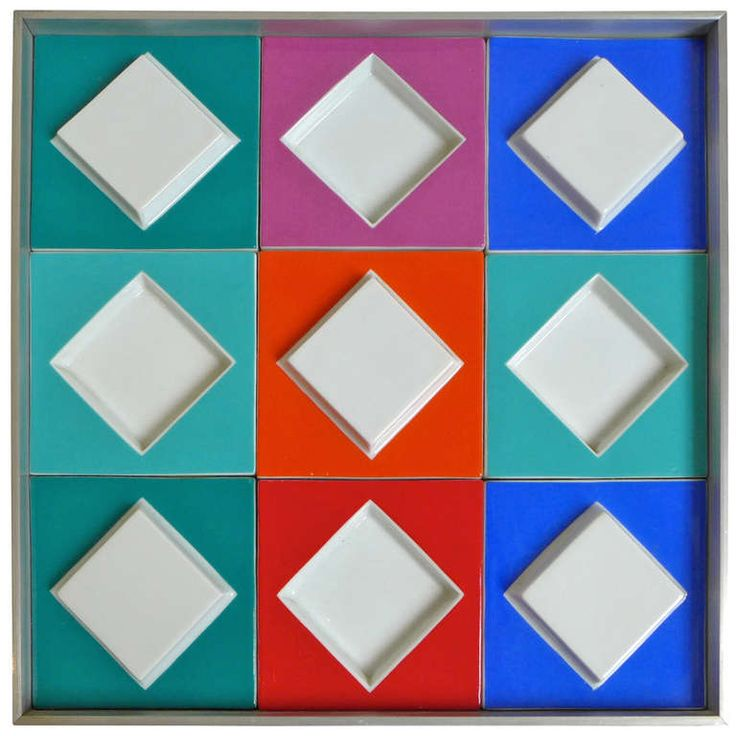 Victor Vasarely for Rosenthal Germany 1970's Porcelain relief composition of nine tiles in an aluminum frame by Op Art master Victor Vasarely. A Studio Line production by Rosenthal in an edition of 100, c. 1970's. Signed and numbered on a plaque on the reverse.