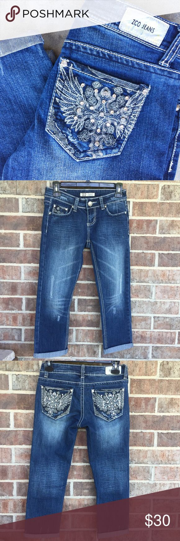 """ZCO Jeans Bling Capris Super cute capris by ZCO Jeans. Bling pockets on the back and cuffed bottoms that can be unrolled. Size 3, be sure and check measurements. Excellent condition - never worn. Waist: about 14"""". Length of capris with cuff: 30"""". ZCO Pants Capris"""