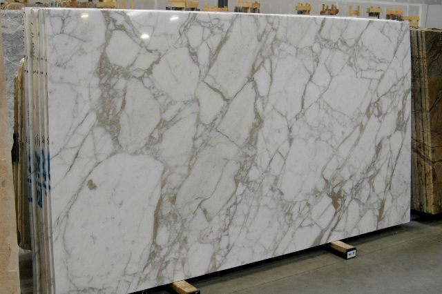 supreme white granite. - someday my kitchen counters are going to be something like this.