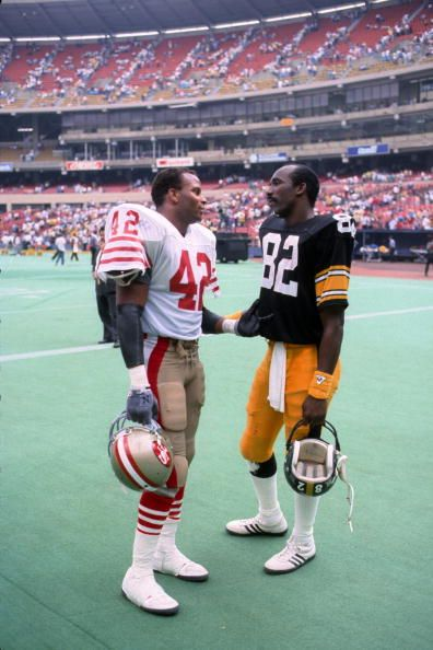 John Stallworth sharing conversation before a game at 3 Rivers with fellow HOF-er Ronnie Lott
