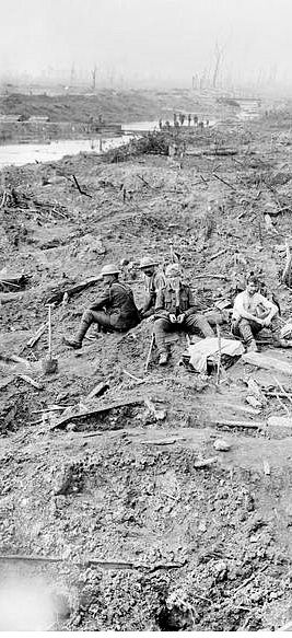 WWI, 5 August 1917; Smashed German trenches and dug-outs near Boezinge. A British working party resting in foreground. Detail. © IWM (Q 3090)
