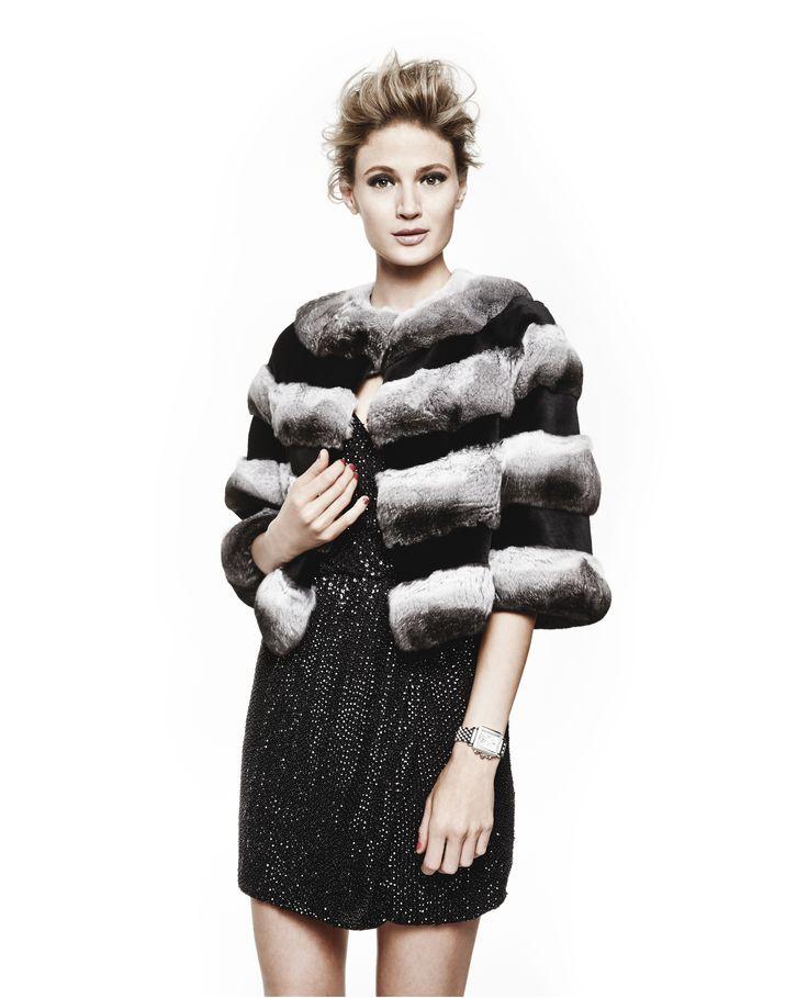 Look haute in the cold weather with Maximilian's black and white chinchilla bolero. (Stay warm, too.)