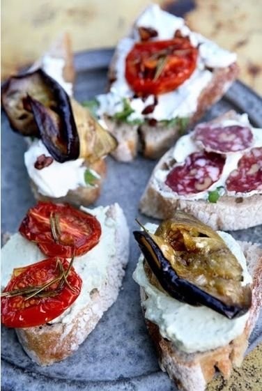 Dine al fresco; tomatoes, aubergine, french bread, soft cheeses and saucisson.