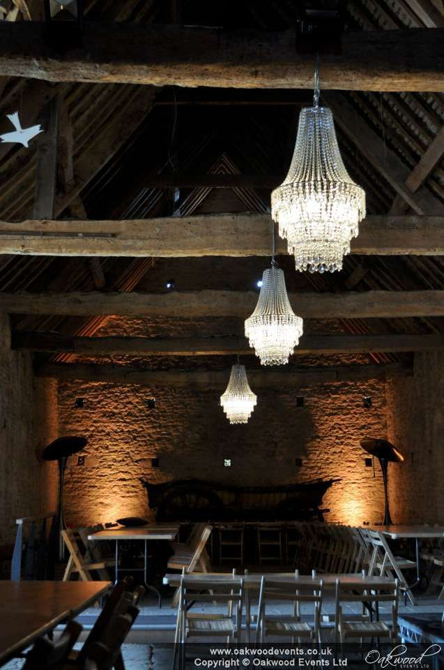 Crystal tiered chandeliers in Cogges barn for a lovely spring wedding