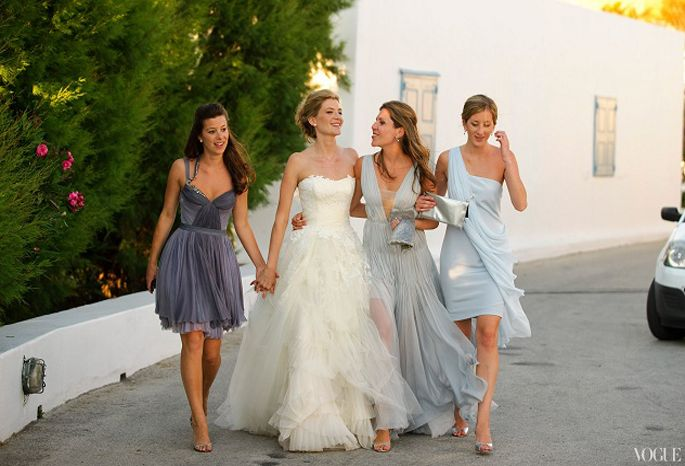 This is from Vogue - love the mismatched gray dresses! I especially love the one to the right of the bride although I would want my BMs to have shorter dresses.