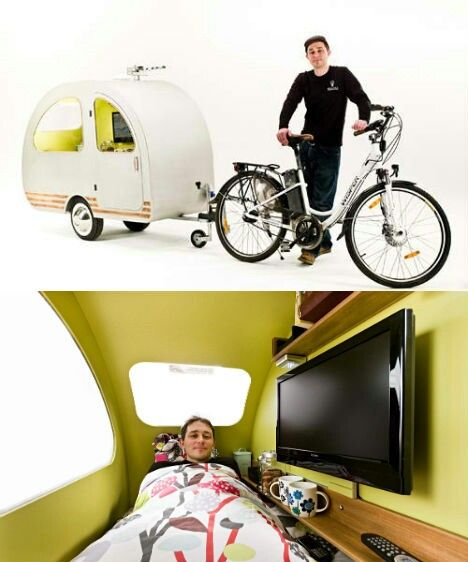 This tiny lightweight bike caravan is fancier inside than you'd expect: it fits a twin bed, a 19″ flat-screen television, an electric kettle for tea and a 'drinks cabinet'. Optional extras include solar roof panels, a satellite dish, a gaming console, central heating and an external luggage rack.