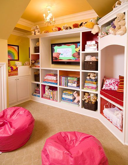 """This child's space was created to entertain the kids while mom works out in the next room. Equipped with multiple reading """"nooks"""", a pass through window with window box conceals crayons, markers and paints.  Storage under the stairs hide additional toys. Photo by Rosh Sillars. Ellwood Interiors Amanda Sinistaj - Berkley, MI"""