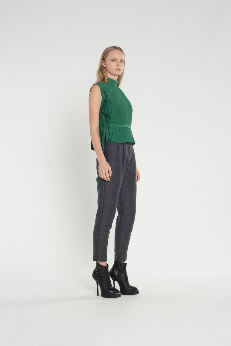 The Unequivocal Top is an edgy and easy piece perfect for both your work and evening wardrobe this winter. #fashion #pleats #green #top